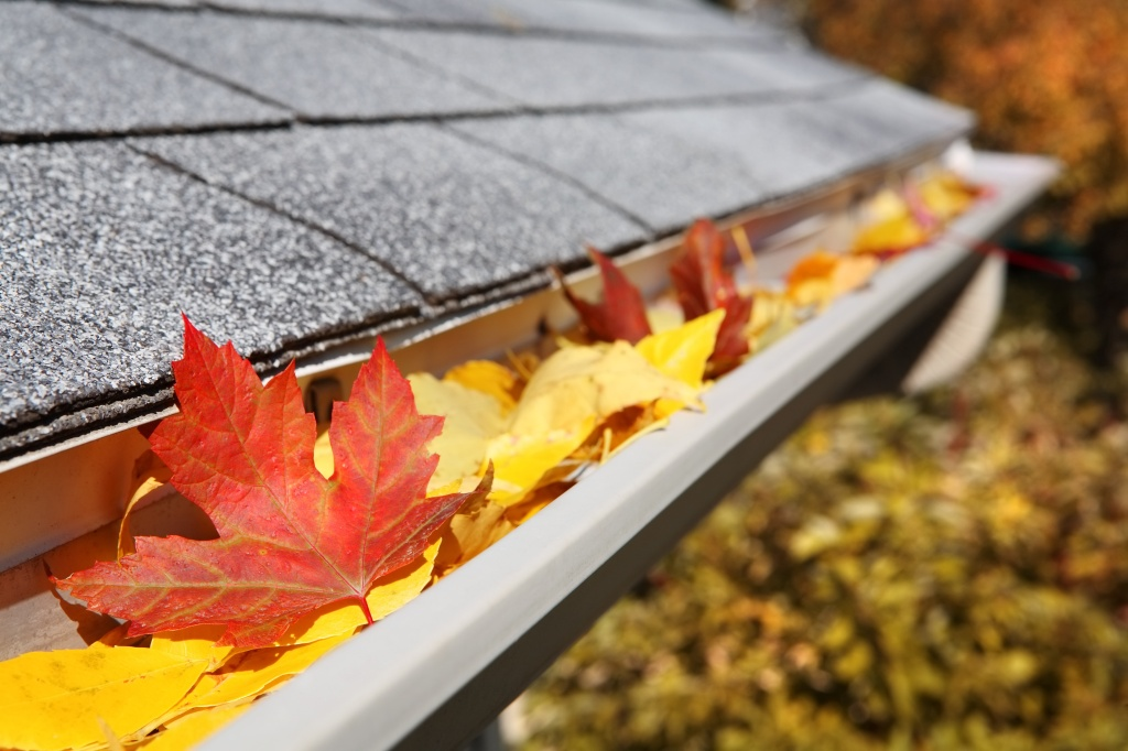 Fall home maintenance includes cleaning and repairing gutters.